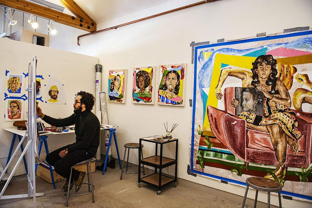 Artist William Osorio paints in his Anderson Ranch studio in Snowmass during his residency on Friday, Feb. 21, 2020. (Kelsey Brunner/The Aspen Times)