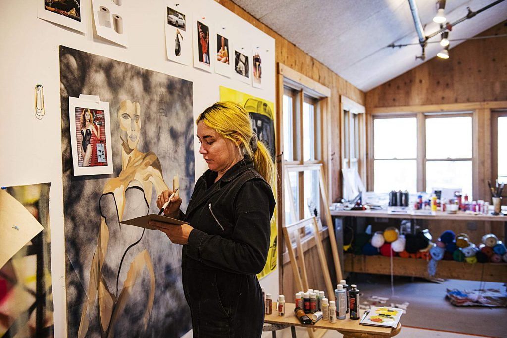 Embroidery and Resin artist-in-residence Kelly Breez works on a poster in her studio at Anderson Ranch on Friday, Feb. 21, 2020. (Kelsey Brunner/The Aspen Times)