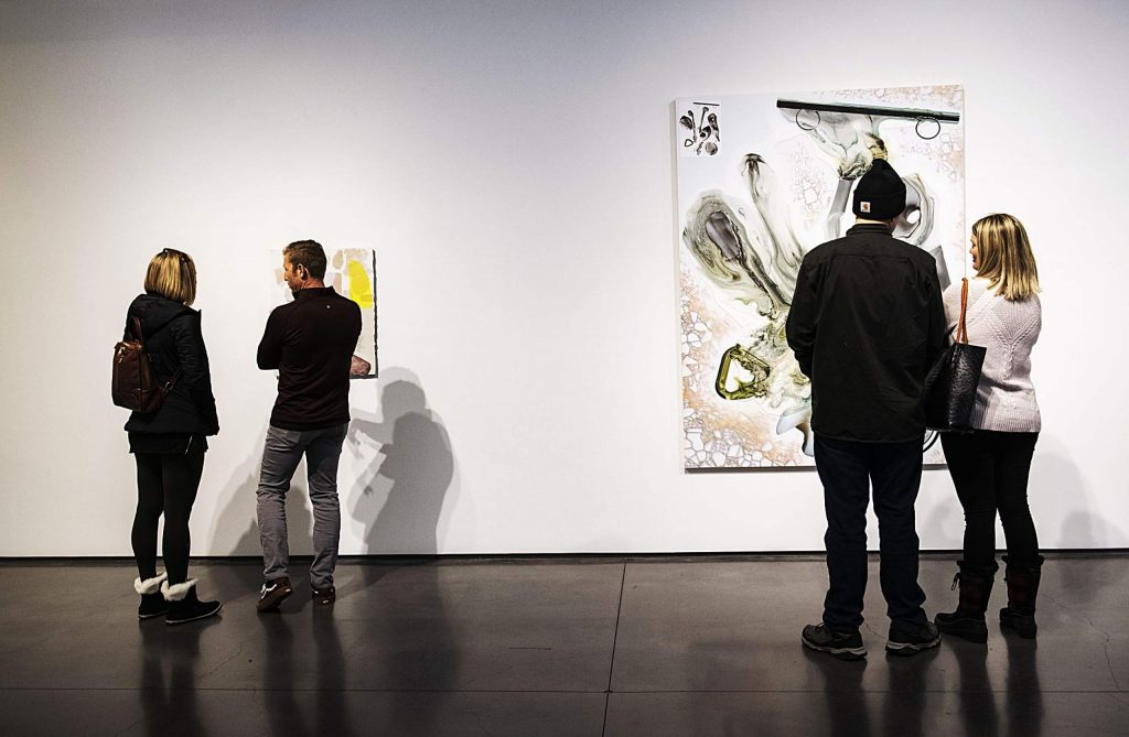 Couples look at art in the Aspen Art Museum during a Challenge Aspen Military Opportunities retreat on Thursday, Feb. 20, 2020. The couples participated in breath work prior to looking at art displayed.