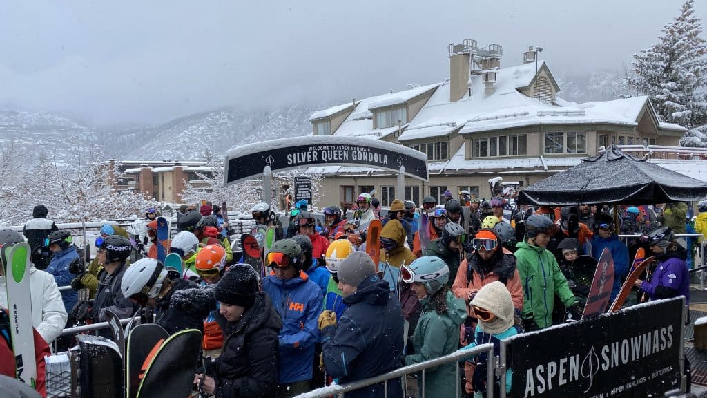 Skiers and snowboarders line up at the Silver Queen Gondola on Monday morning for first tracks. Aspen Mountain picked up 5 inches of snow overnight.