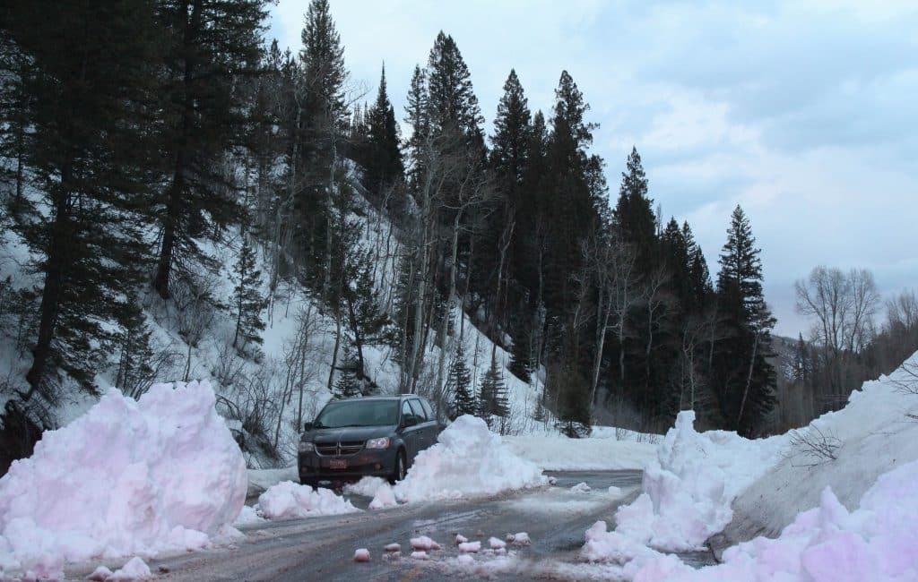 A vehicle high-centered after attempting to drive through a small snow slide on Castle Creek Road March 8, 2020, Pitkin County officials said. (Maddie Vincent/The Aspen Times)