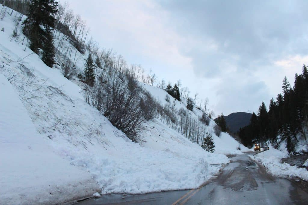 Several small snow slides covered Castle Creek Road between mile markers 3 and 4 on March 8, 2020. No one was injured and the roadway was cleared that evening. (Maddie Vincent/The Aspen Times)