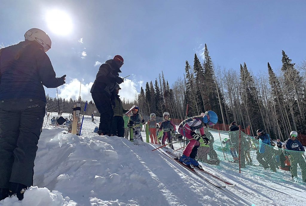 A young ski racer leaves the starting gate on Joslin at the Buddy Werner finals March 1 at Sunlight Mountain Resort.