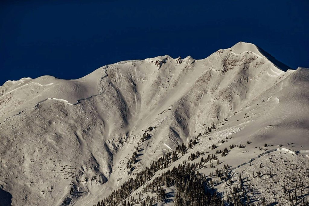A large natural avalanche released on Garrett Peak, which can be seen from Snowmass Ski Area, on March 13, 2019. Scouring the entire mountain along with some adjacent slopes, the slide was one of the three most destructive in Colorado's history, all occurring last March.