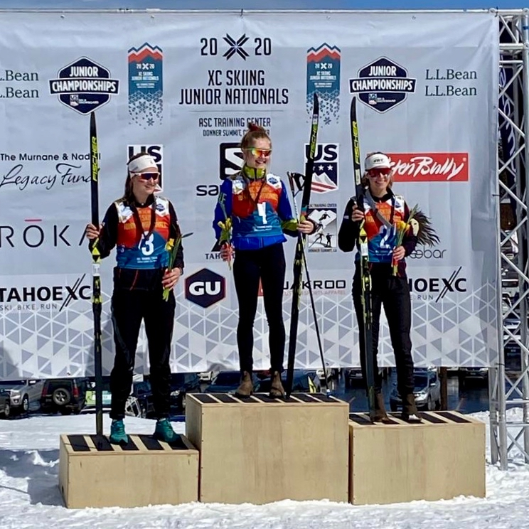 AVSC's Kate Oldham, left, stands on the U18 women's classic podium after taking third to winner Nina Seemann, center, and Vail's Emma Reeder.