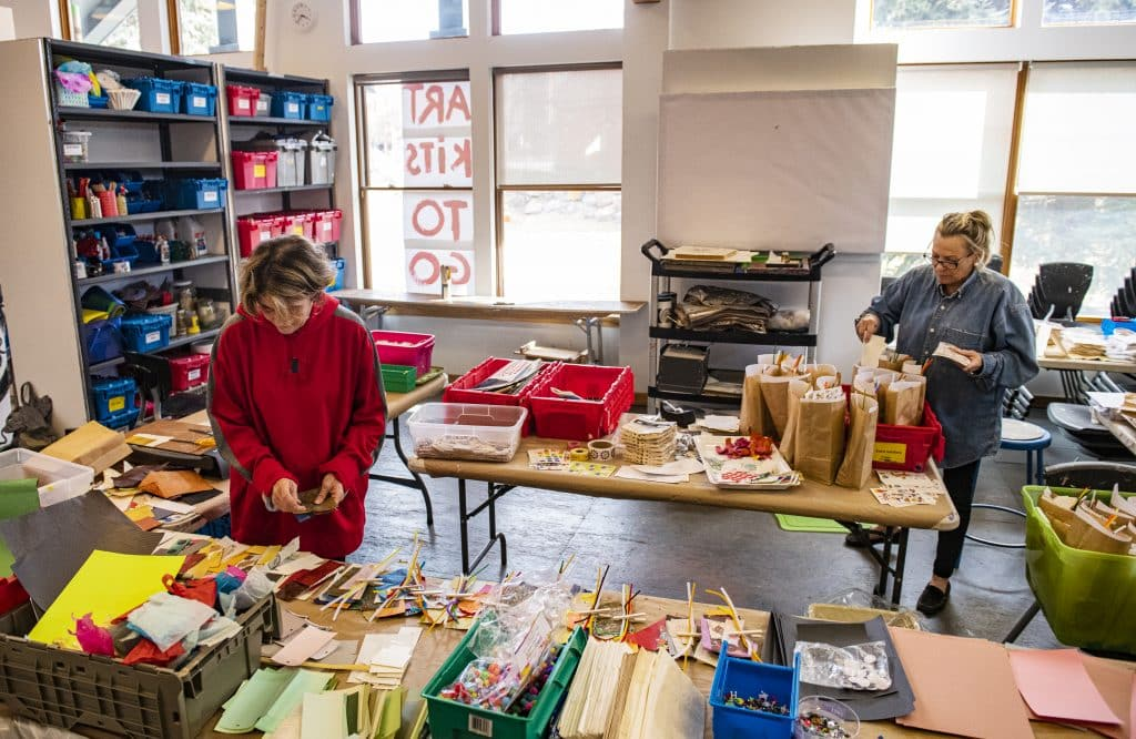 Basalt Art Base volunteer Sharon Wells, left, and studio manager Dana Higbie make art kits for kids to pick up on Tuesday, March 17, 2020.