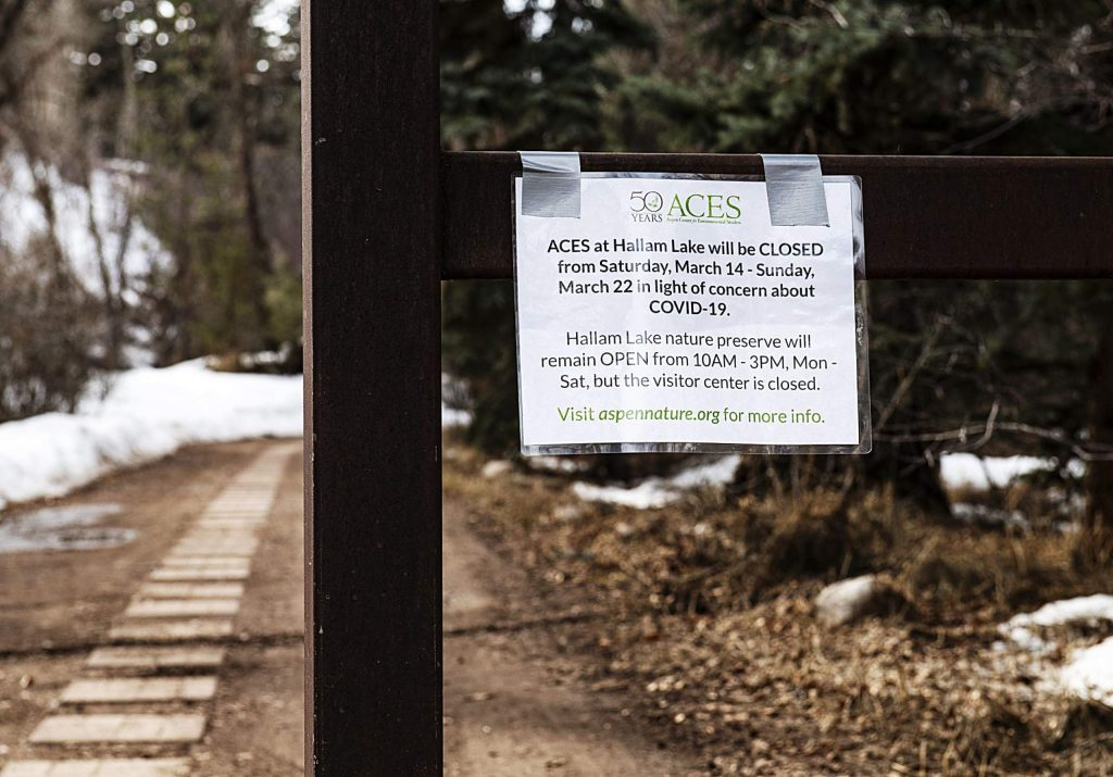 A notice hangs on a wrought iron gate outside of ACES at Hallam Lake in Aspen on Wednesday, March 18, 2020. (Kelsey Brunner/The Aspen Times)