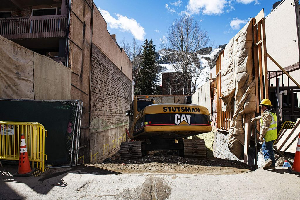 Construction on a building off of the Hyman walking mall continues in Aspen on Tuesday, March 24, 2020. (Kelsey Brunner/The Aspen Times)