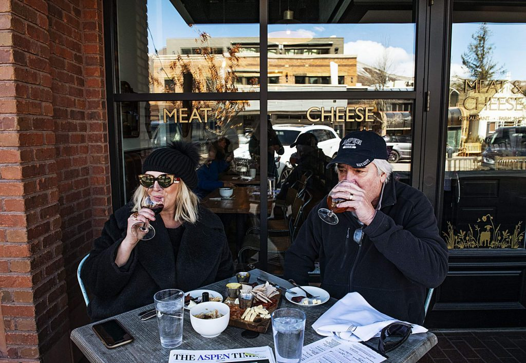 Polly and David Dunn enjoy lunch at Meat and Cheese during one of their stays in Aspen on Saturday, March 13, 2020. (Kelsey Brunner/The Aspen Times)
