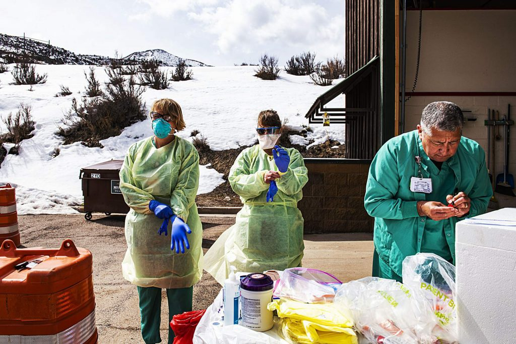 Healthcare providers prepare for their first scheduled appointment at a coronavirus testing location at the Aspen Volunteer Fire Department's Aspen Village Location on Thursday, March 12, 2020.