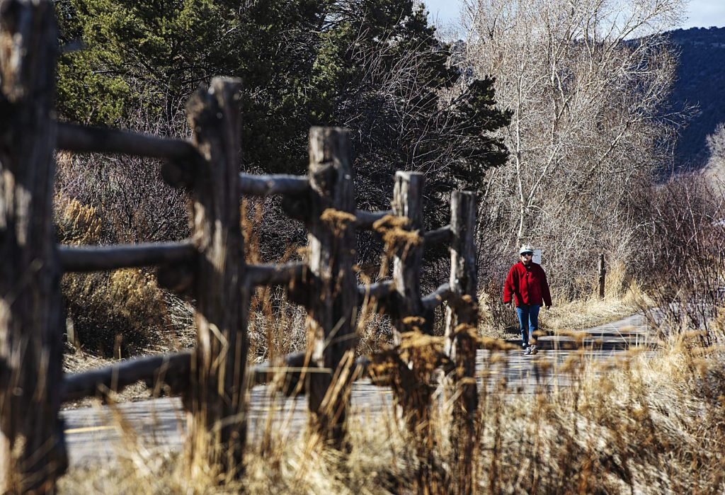 A woman walks on the Rio Grande Trail in Basalt on Tuesday, March 24, 2020. (Kelsey Brunner/The Aspen Times)