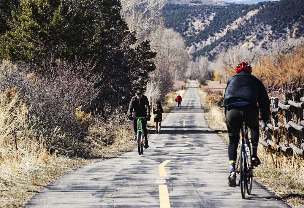 People enjoy the Rio Grande Trail in Basalt on Tuesday, March 24, 2020. (Kelsey Brunner/The Aspen Times)