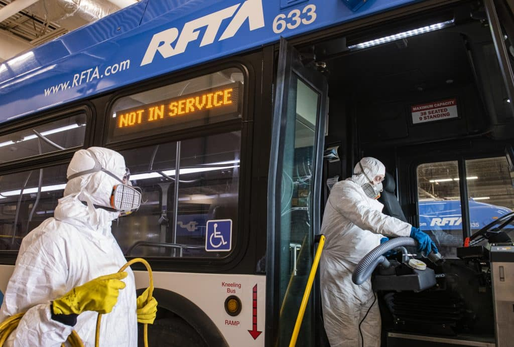 RFTA lead mechanic Will Fabela, right, and Patricia Rosales Trigo disinfect a bus at the Aspen Maintenance Facility on Thursday, March 12, 2020.
