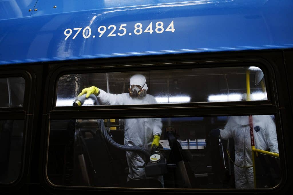RFTA employee Patricia Rosales Trigo, left, and lead mechanic Will Fabela disinfect a bus at the Aspen Maintenance Facility on Thursday, March 12, 2020.