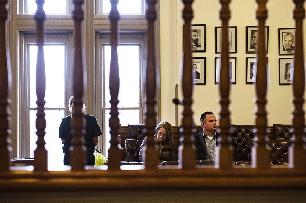 Derek Johnson sits in the jury box Tuesday with his Denver-based lawyer, Pamela Mackey, after being sentenced to six years in prison for stealing and selling more than 13,000 pairs of skis that belonged to his employer, the Aspen Skiing Co.. (Kelsey Brunner/The Aspen Times)