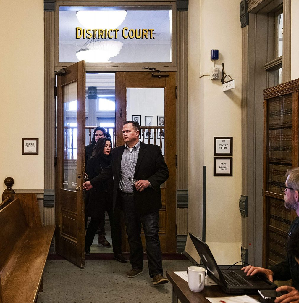 Former Aspen Skiing Co., executive Derek Johnson leaves the Pitkin County District courtroom Tuesday, followed by his wife and son, after being sentenced to six years in prison for stealing and selling $6 million worth of skis that belonged to his employer. (Kelsey Brunner/The Aspen Times)