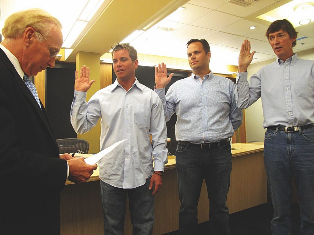 Municipal Judge Brooke Peterson swearing in newly elected Aspen City Council members, from left to right, Torre, Derek Johnson and Mick Ireland in June 2009.