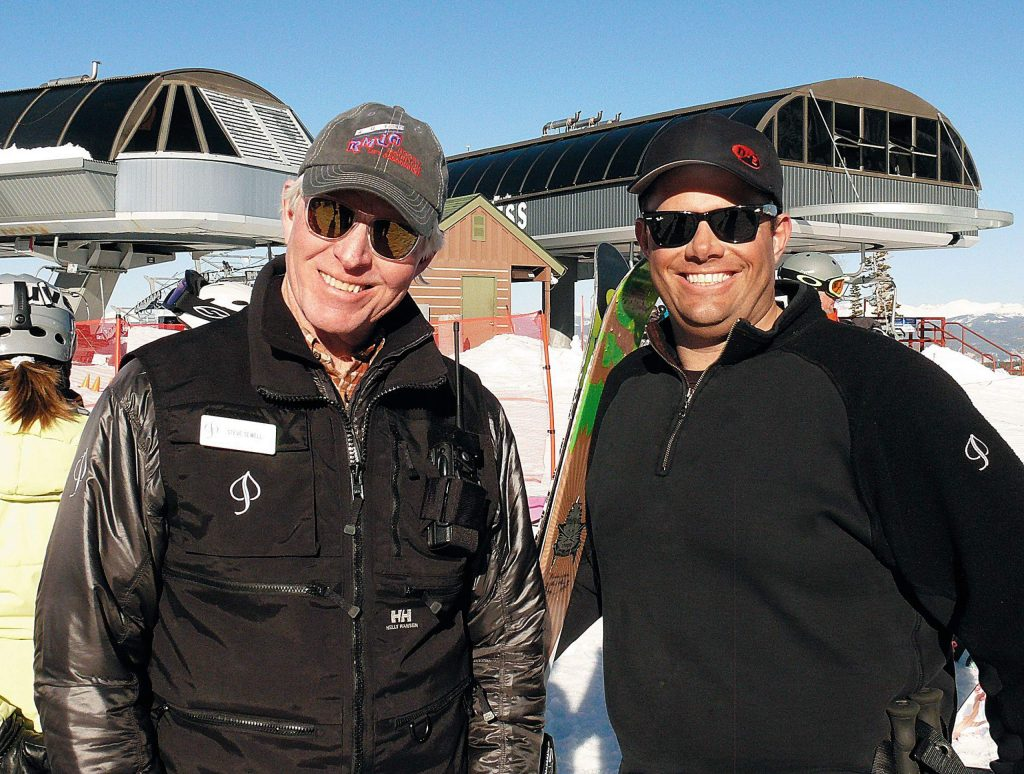 Derek Johnson, right, with Snowmass mountain manager Steve Sewell in 2011.