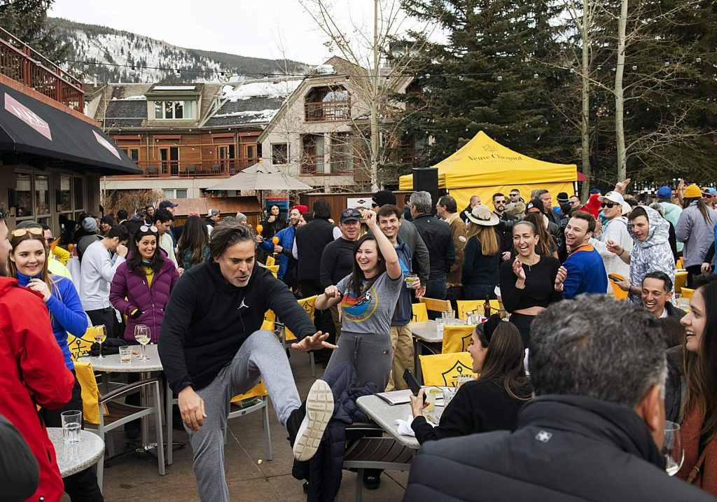 People cheer on a man as he dances during Aprés at Ajax Tavern in Aspen on Saturday, March 7, 2020.