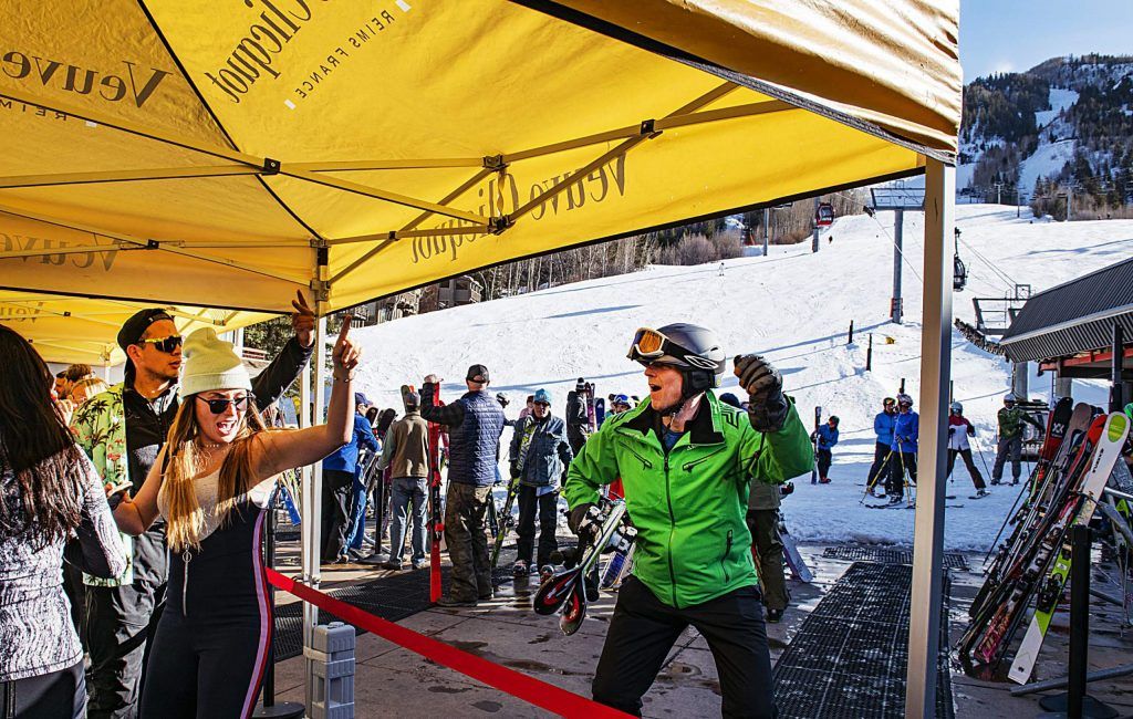 A skier joins in on the dance party at the Veuve Clicquot Aprés popup at Ajax Tavern on Friday, March 6, 2020.