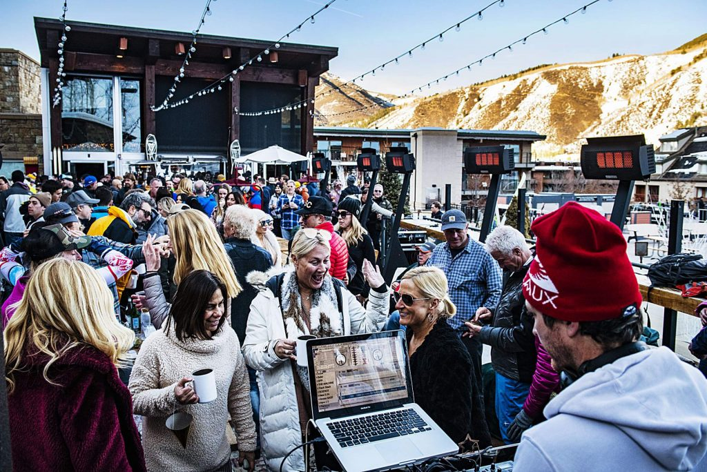 People dance as a DJ performs at the Snow Lodge at the base of Aspen Mountain on Thursday, March 5, 2020.