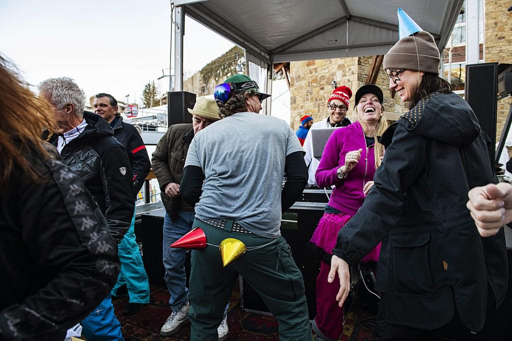 People dance as a DJ performs at the Snow Lodge for Aprés on Thursday, March 5, 2020.