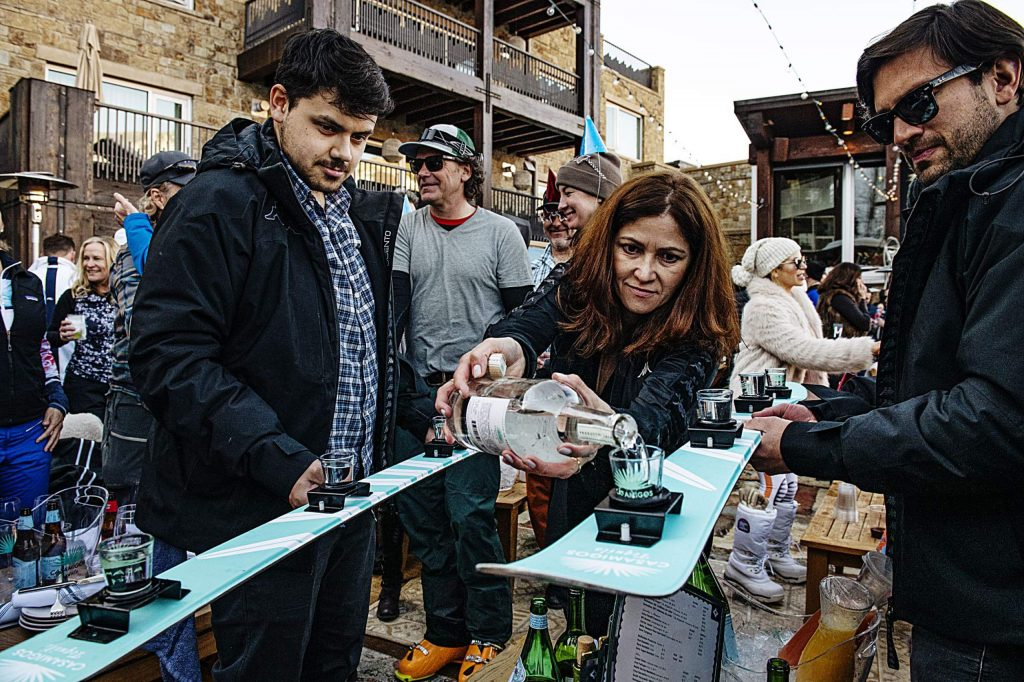 A Snow Lodge employee pours tequila into shot skis during Aprés on Thursday, March 5, 2020.