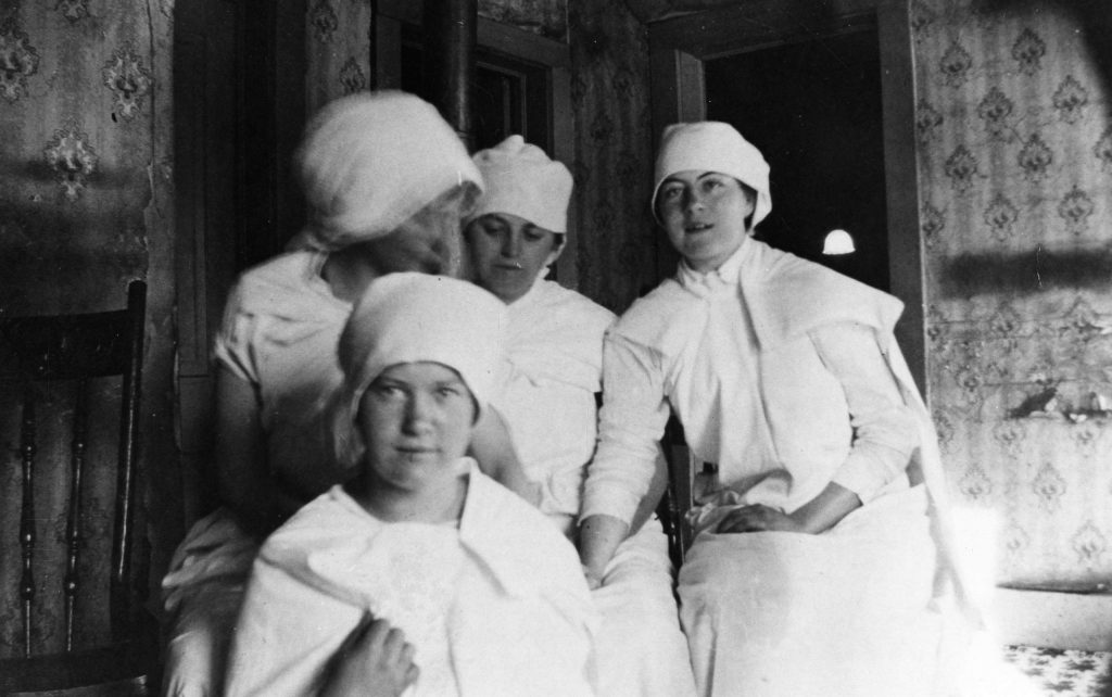 Four women wearing nursing outfits and surgical gowns at the Citizens Hospital in Aspen, 1913