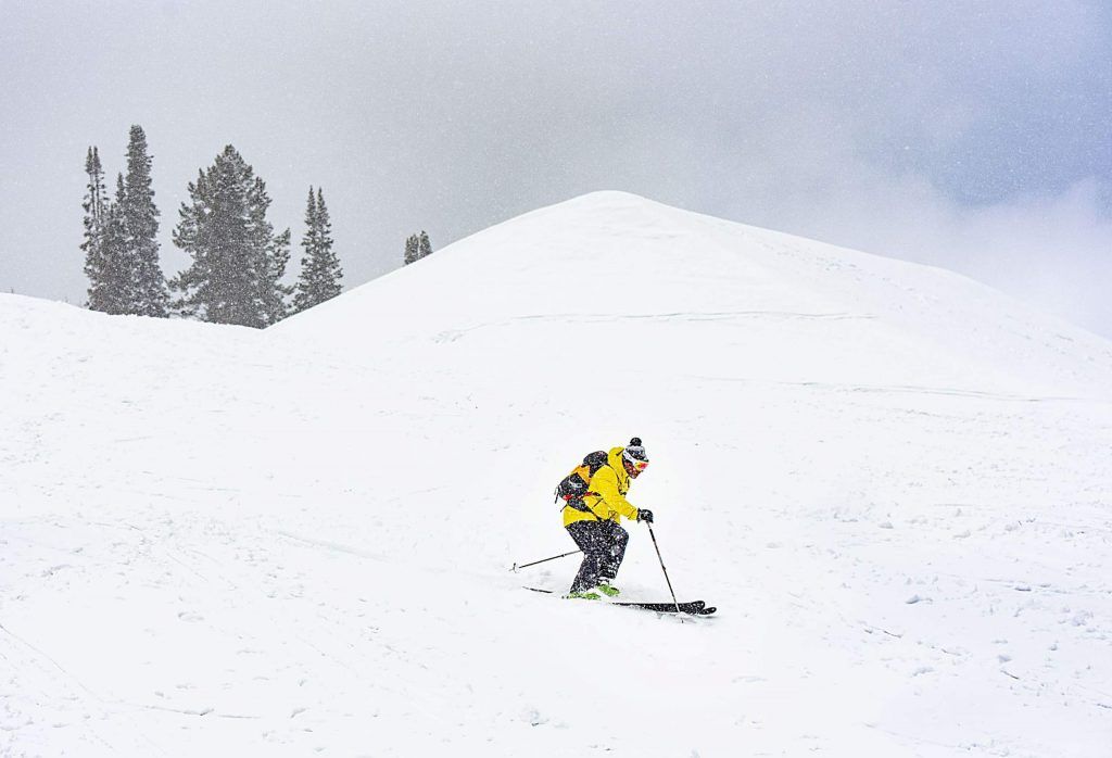 A man skis down on the closed Buttermilk resort on Friday, March 20, 2020. (Kelsey Brunner/The Aspen Times)