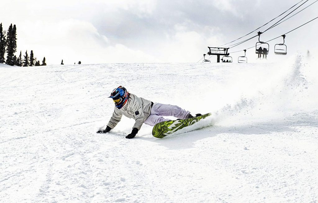 Aspen local John Gilmour deeply carves down Ruthie's Run on Aspen Mountain on the season's 50th day in 2020 on Wednesday.