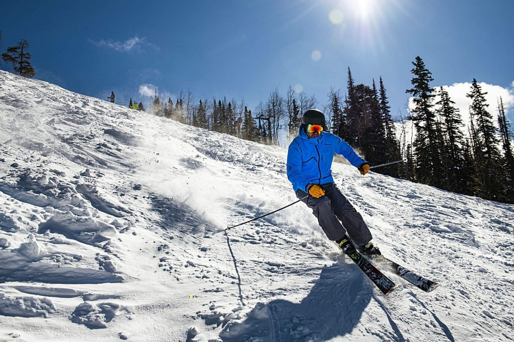 Jeff Micsky skis down the Face of Bell on a bluebird Aspen Mountain day on Thursday, Feb. 27, 2020. Next year, Ikon Base Pass holders will have to pay $150 more to include days at Aspen Snowmass and Jackson Hole resorts.(Kelsey Brunner/The Aspen Times)
