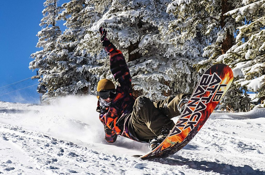Oliver Rudd snowboards on opening day of Aspen Mountain on Saturday, November 23, 2019. Rudd lives in Carbondale, Colorado. He's a passionate snowboarder and surfer. (Kelsey Brunner/The Aspen Times)