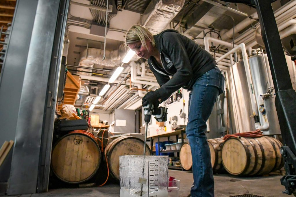 Connie Baker, head distiller at Marble Distilling Co. mixes a new batch of hand sanitizer at the distillery in downtown Carbondale.