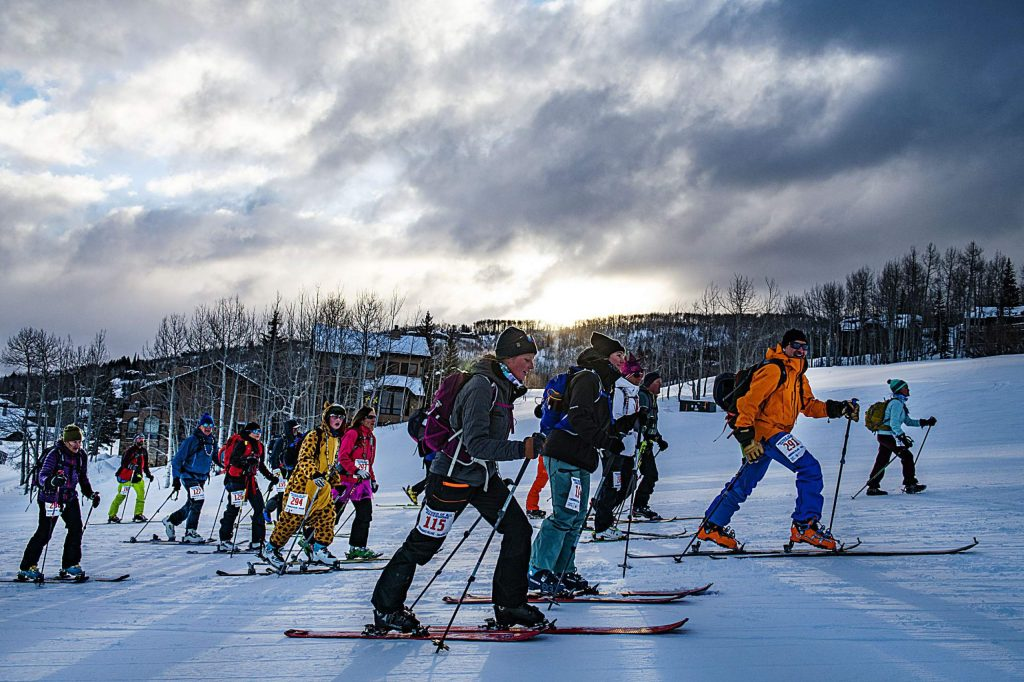 Uphill racers make their way up Fanny Hill to Gwyn's High Alpine during the Mother of all Ascensions event for Mardi Gras in Snowmass on Tuesday, Feb. 25, 2020. (Kelsey Brunner/The Aspen Times)