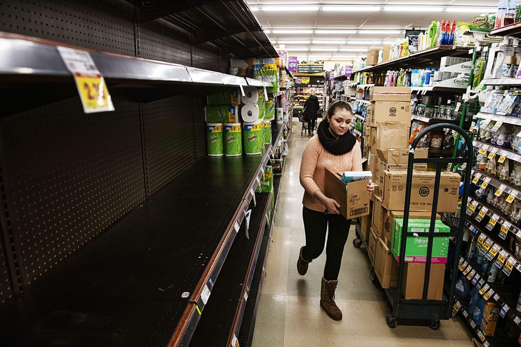 City Market employees stock shelves with cleaning supplies in Aspen on Friday, March 13, 2020.