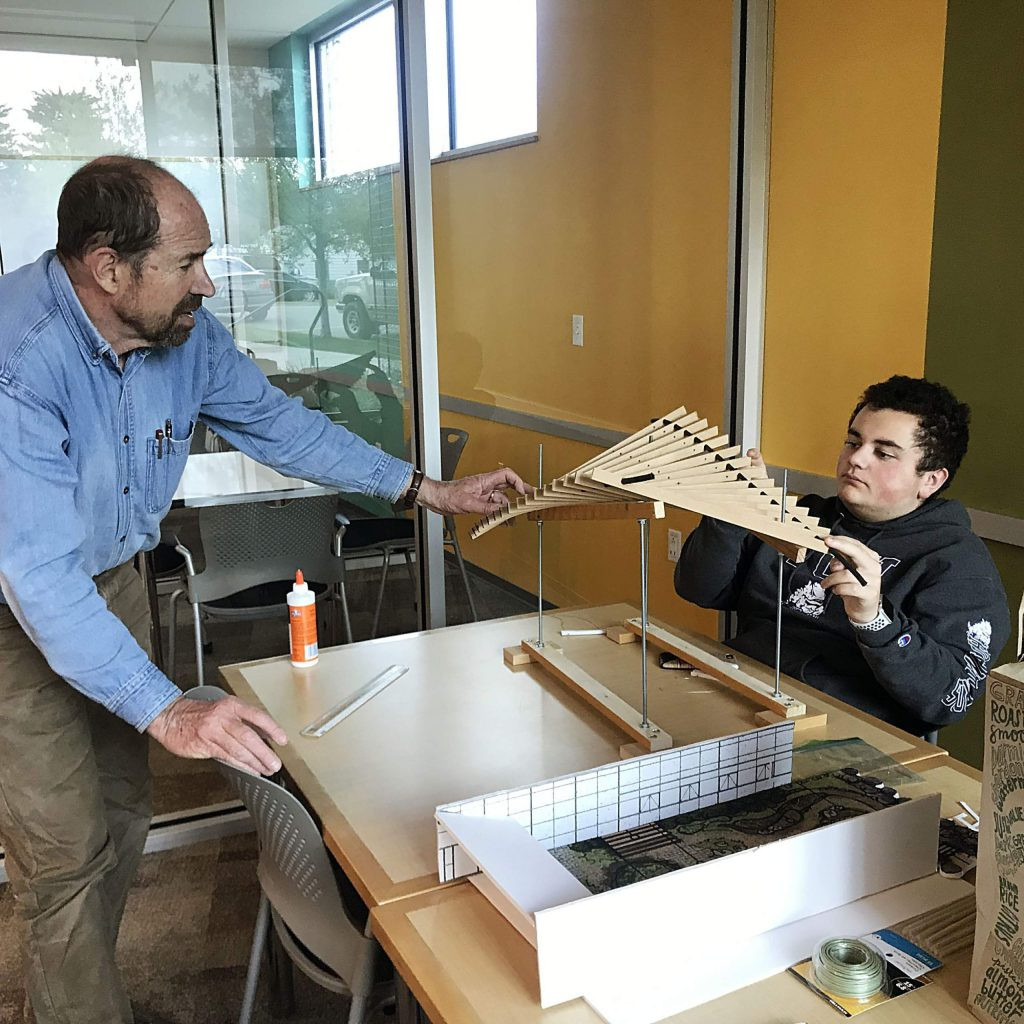 Robert Pattillo (left), a structural engineer, and Basalt High School student Austin Pagan work on a model of a shade structure for the Peace Garden.