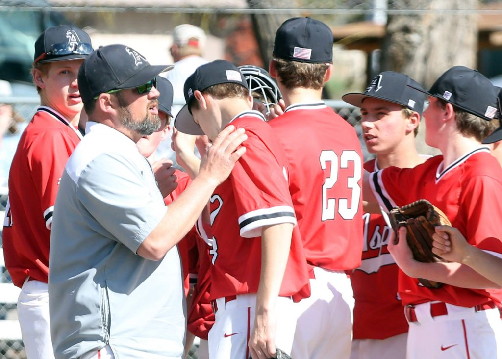 Aspen High School baseball coach Brian Bradford talks to the players between innings against Steamboat Springs on Monday, April 8, 2019, at Crawford Field in El Jebel.