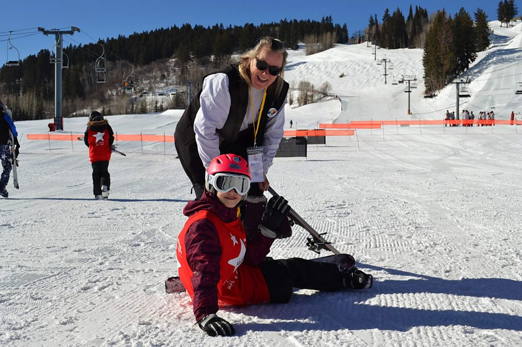 Marilyn Bloom skis with Shining Star Nadia Burnett on Saturday, Feb. 29, 2020 as part of the Shining Stars Foundation's 2020 Aspen Winter Games, a weeklong series of winter activities designed specifically for children with cancer or other life threatening illnesses.