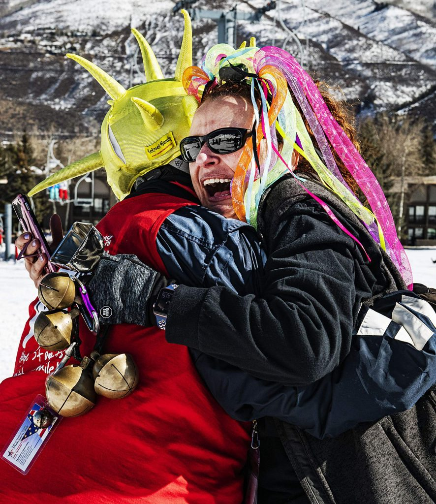 Shining Stars nurse Lauree Deublein, right, hugs Alexis Herman, 15, after she finished her run during the Aspen Winter Games at Buttermilk on Thursday, March 5, 2020. Both Deublein and Herman are from Phoenix, Arizona.