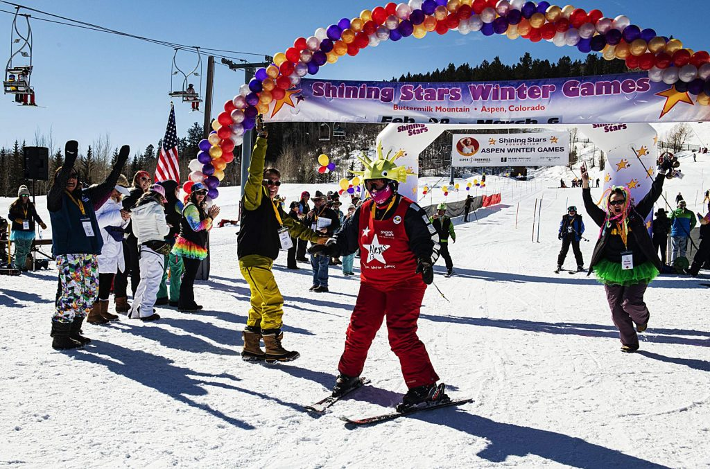 Spectators cheer for Alexis Herman, 15, after she crossed the finish line during the Shining Stars Aspen Winter Games at Buttermilk on Thursday, March 5, 2020.