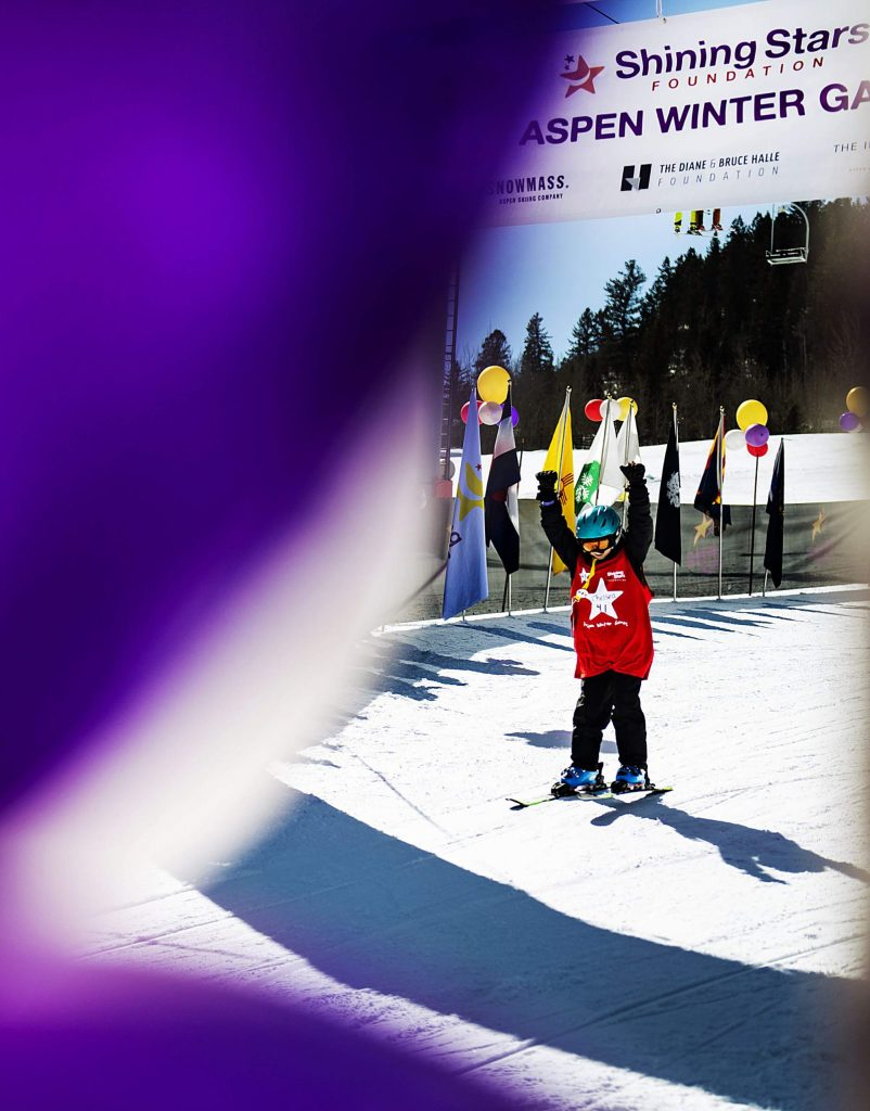 Shining Stars' Chelsea Craver, 9, crosses the race finish line during the Aspen Winter Games at Buttermilk on Thursday, March 5, 2020.