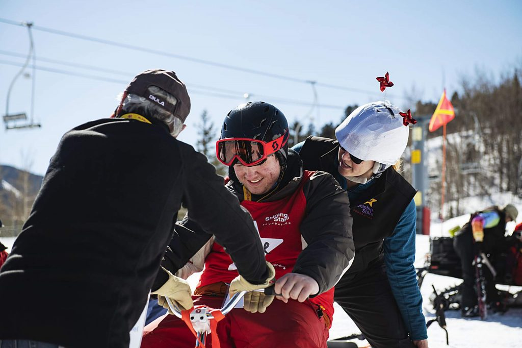 A Shining Stars child talks to volunteers at the top of the race course during the Aspen Winter Games at Buttermilk on Thursday, March 5, 2020.