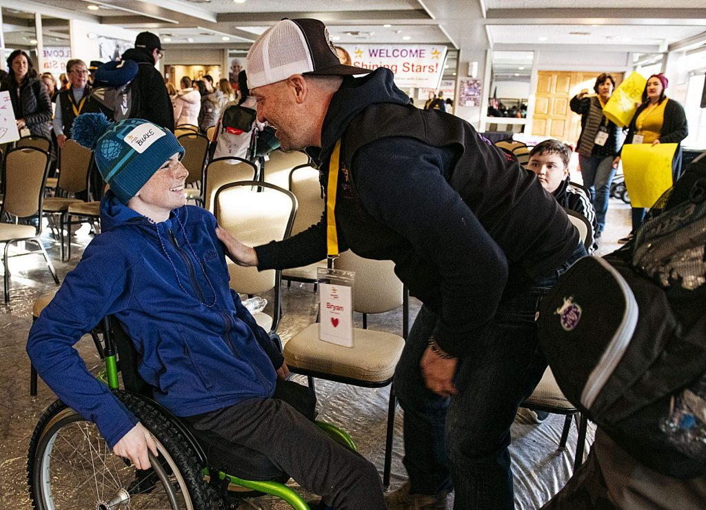 Shining Stars Burke Ryder, 15, and his buddy Bryan Cournoyer talk after settling in on arrival day at the Aspen Inn on Friday, Feb. 28, 2020.