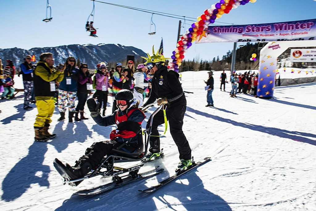 A Shining Stars racer finishes a run to the cheering of spectators during the Aspen Winter Games at Buttermilk on Thursday, March 5, 2020.