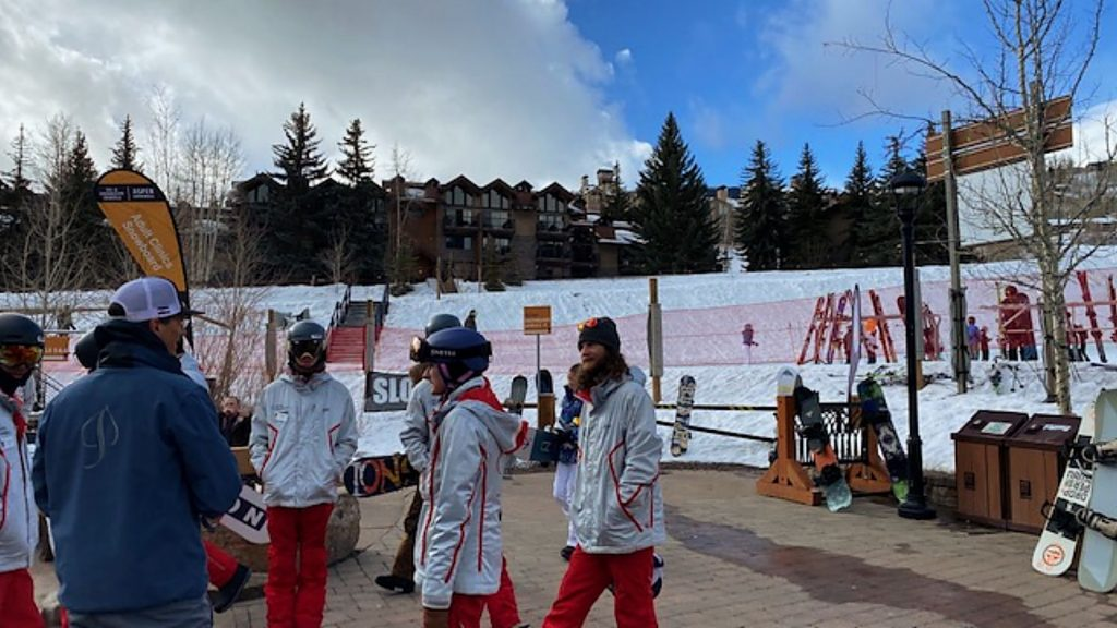 Aspen Skiing Co. President and CEO Mike Kaplan, in blue jacket, meets with ski pros at Snowmass Base Village on the morning of Saturday, March 14.