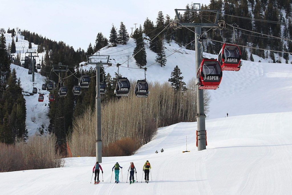 A group of women skinned up the Little Nell run Sunday, March 15, 2020 beneath stationary Silver Queen Gondola cars. It was the morning after Gov. Jared Polis issued an executive order closing all Colorado ski areas.