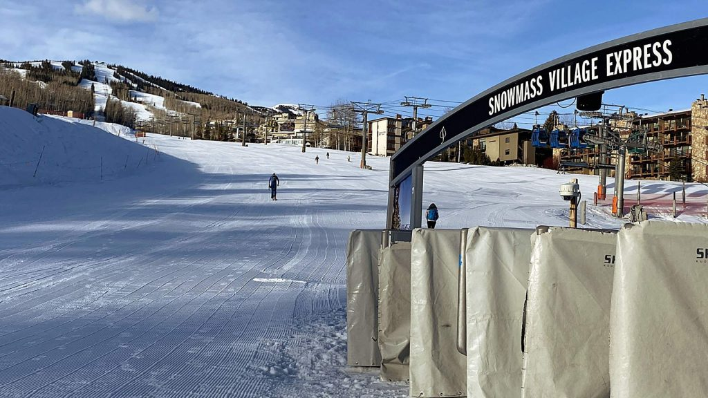 An uphill skiers heads out of the Snowmass Base Village area Sunday morning just before 8:30 a.m., which is the time the Village Express lift usually opens.