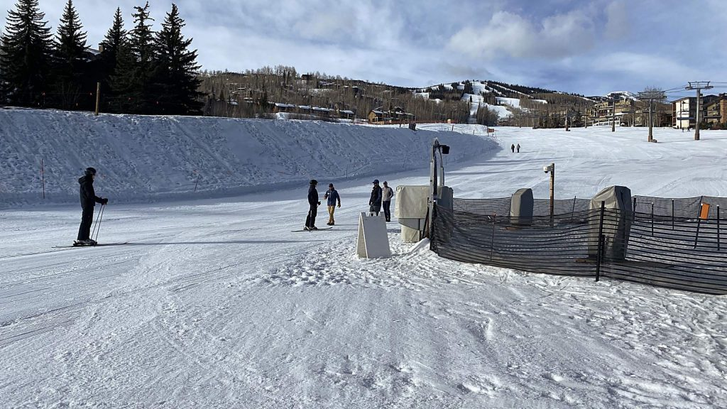 David (left) and Therese Akers of Tulsa skied down Fanny Hill on Sunday morning to the Village Express lift at Snowmass. They got to town Saturday night and did not know the resort was closed down by the governor's order.