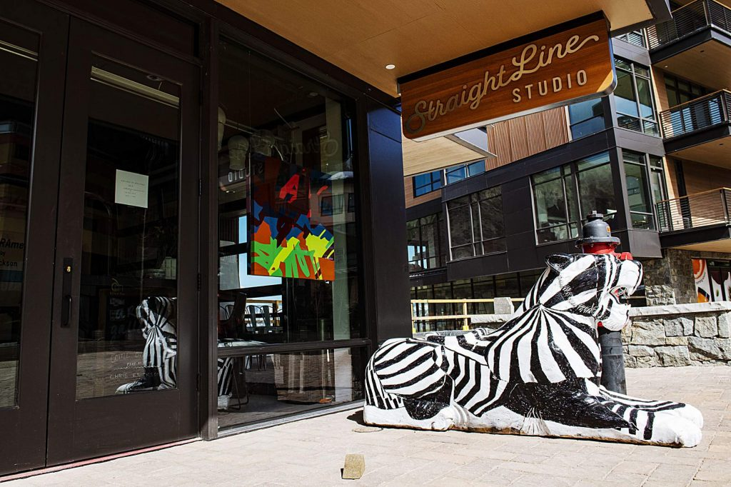 A wooden tiger sits outside of Straight Line Studio in Snowmass Base Village after being moved from the parking garage on Thursday, March 26, 2020. (Kelsey Brunner/The Aspen Times)