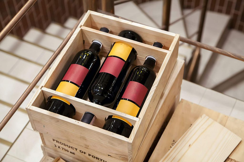 bottle of red wine in a wooden box